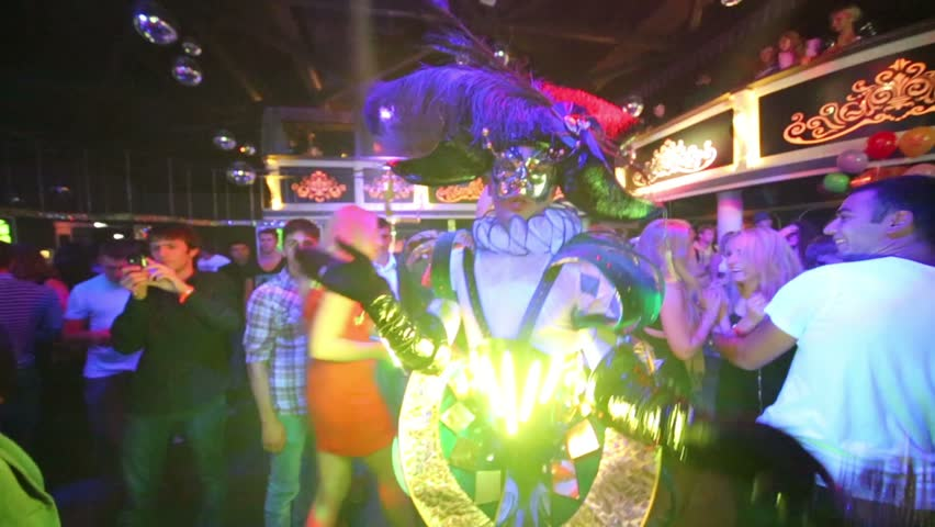 MOSCOW, RUSSIA - SEP 21, 2012: Actor dressed as Harlequin performs at dancefloor in night club Base during DJ Solovey birthday party. - HD stock video clip