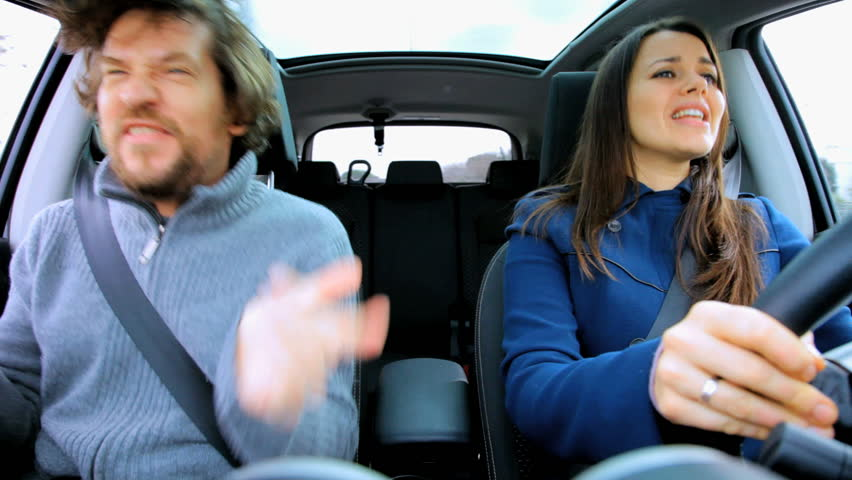 Couple in moving car dancing like crazy happy about going in vacation - HD stock footage clip