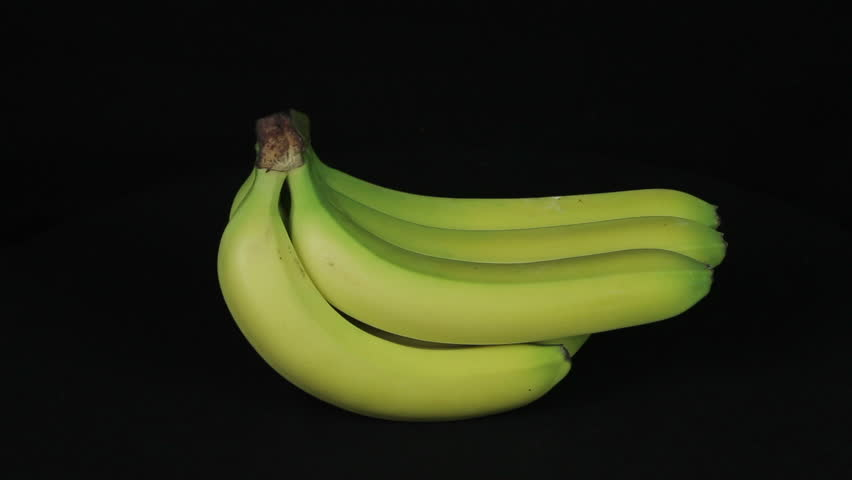 Bunch of bananas rotates on a black background  loop - HD stock video clip