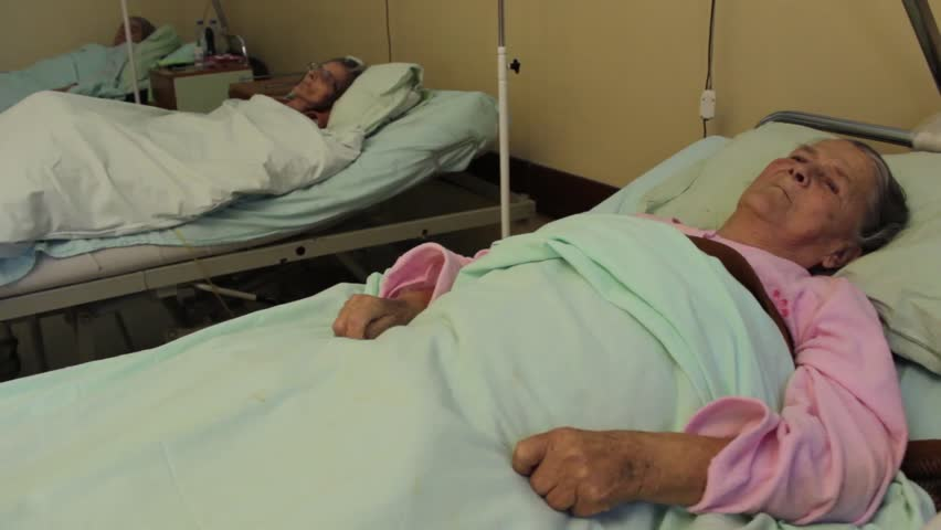 Sick Patient In Hospital Bed : 30.01.2014. Public hospital. Old woman, patient lying in hospital bed ...