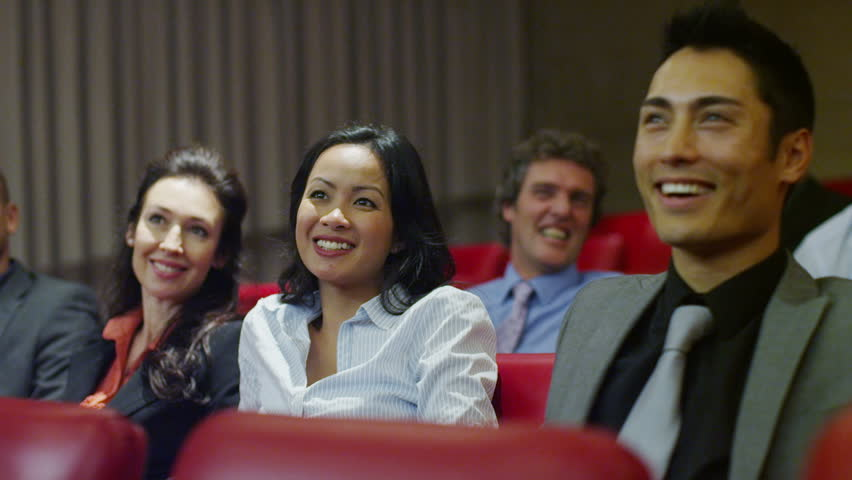 Cheerful diverse business team attending a business presentation or training seminar in company lecture theatre. - 4K stock video clip