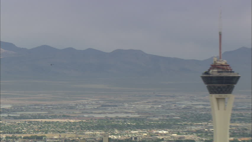 Flying Helicopter Las Vegas. Shot of a flying helicopter above the Las Vegas strip. Mountains are in the background behind the helicopter. - HD stock footage clip