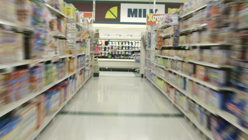 Perspective from a shopping cart as it races through the aisles of a supermarket grocery in time lapse.