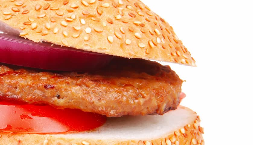 big double hamburger on ceramic plate with cutlery 1080p 1920x1080 intro motion slow hidef hd