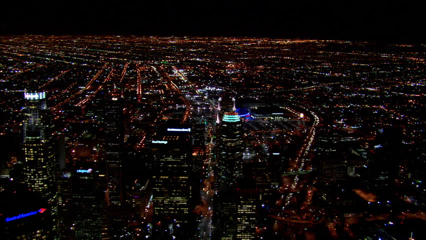 Downtown Los Angeles Night. This clip is an aerial wide shot of downtown Los Angeles, California lit up at night.