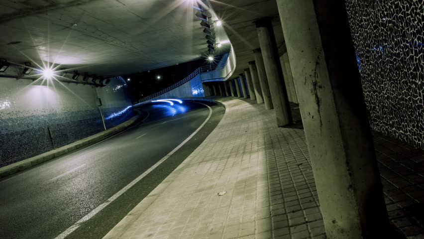 4K Time lapse sequence of traffic in a citys tunnel