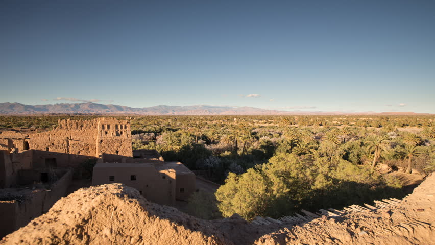 Timelapse of sunset at Oasis with traditional Kasbah, Skoura, Morocco