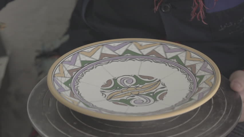 Close up of hands of Craftsman painting a ceramic plate | Shutterstock HD Video #5752352