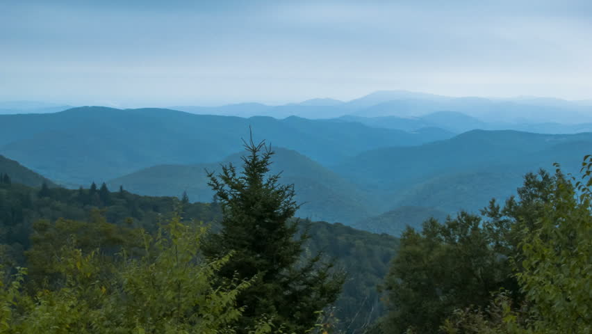 Panning Over the Mystical Smoky Mountains at Dusk. Seen from an Overlook on the Blue Ridge Parkway near Asheville, North Carolina in Summer.