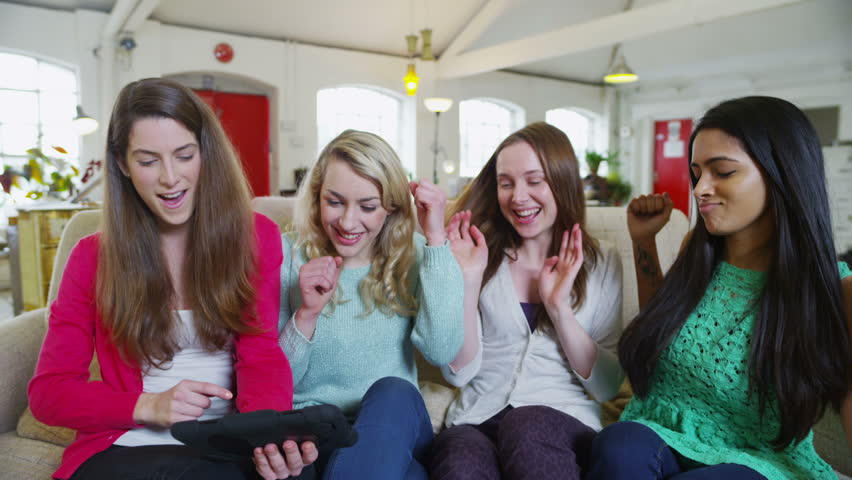 happy and casual group of young female friends hanging