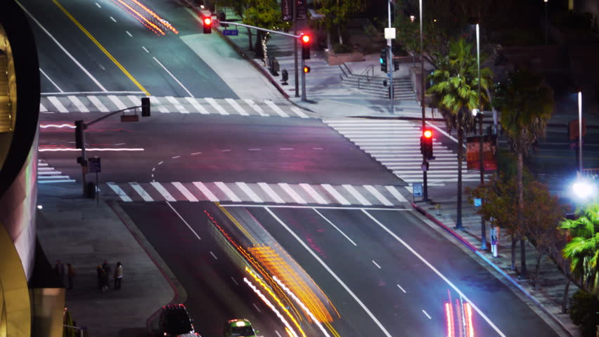 Time Lapse of Traffic at Intersection at Night -Zoom In- - HD stock footage clip