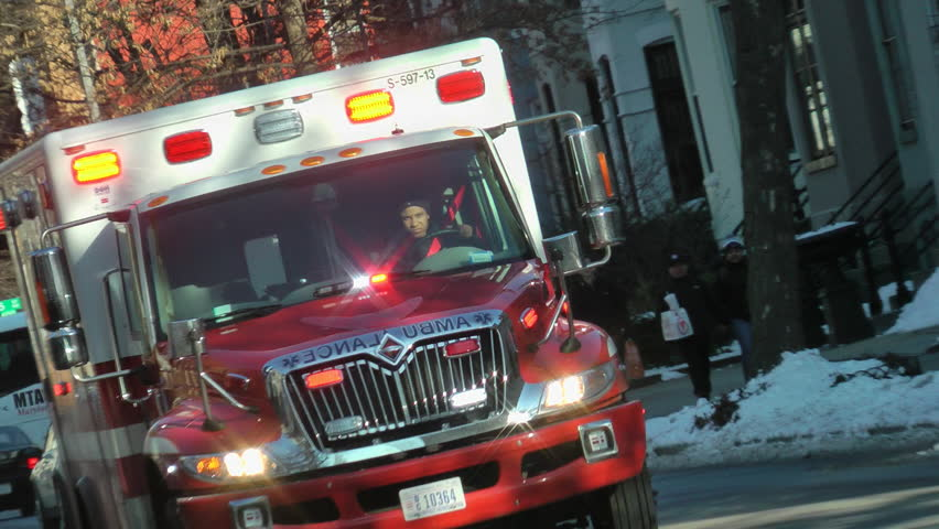 WASHINGTON, DC - MARCH 5:  EMS ambulance approaches, then reverse angle as recedes, responding, siren, lights.  EMS is part of DC Fire & EMS department (DC FEMS) - HD stock video clip