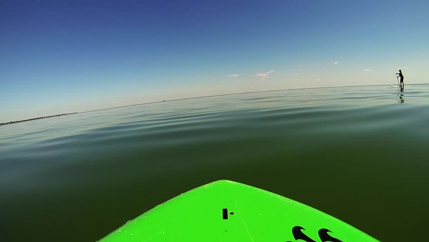 Paddleboarding on super smooth waters - HD stock footage clip