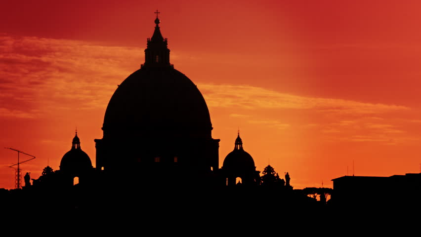 Close up of St Peter's Basilica silhouetted against a sunset - 4K stock footage clip