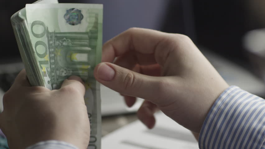 Businessman is Counting Euro Bills. Shot on RED Digital Cinema Camera in 4K (ultra-high definition (UHD)), so you can easily crop, rotate and zoom, without losing quality.