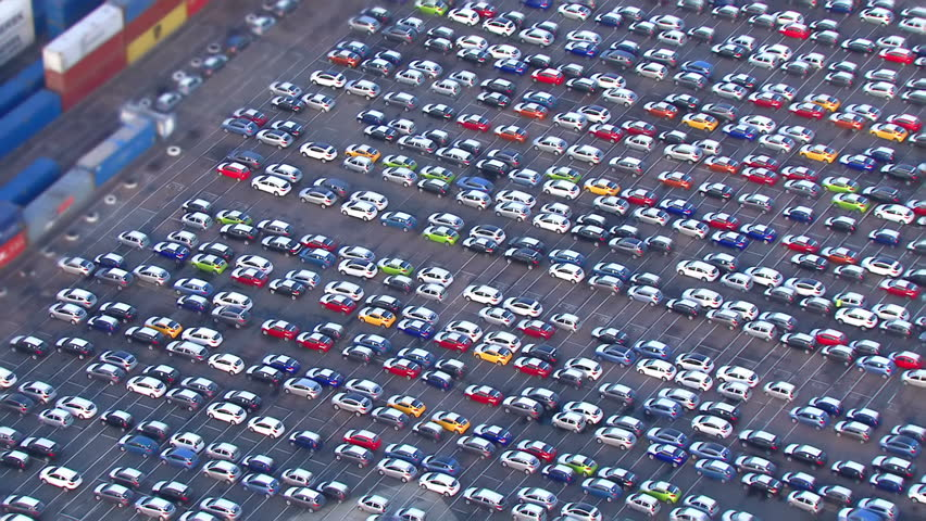 Aerial view of cars and containers lined up at a busy London port. - HD stock video clip