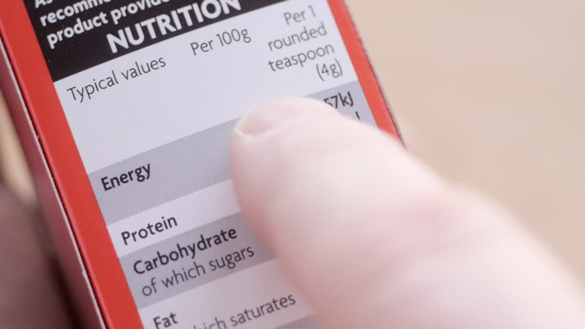 Reading nutritional information label on food packet
