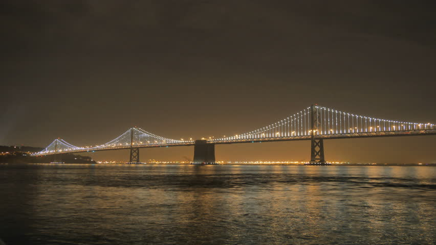 San Francisco, California - November 29, 2013 - 4k resolution time lapse of the San Francisco Bay Bridge lit up at night.