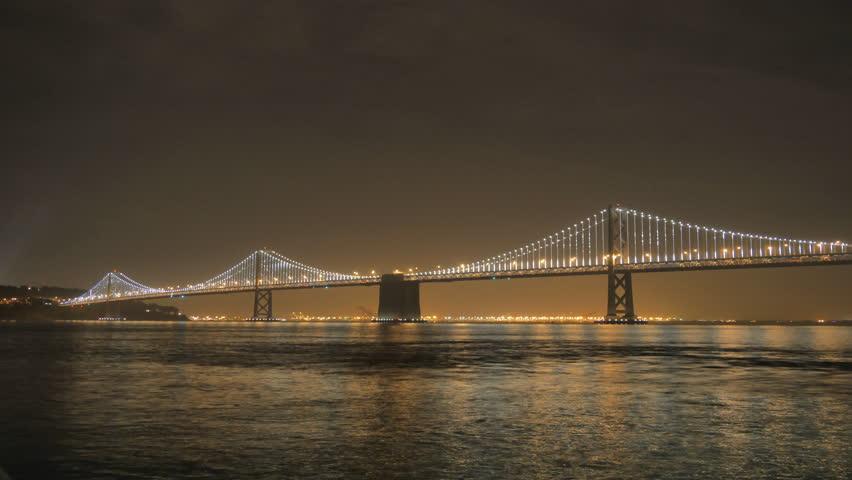 San Francisco, California - November 29, 2013 - 4k resolution time lapse of the San Francisco Bay Bridge lit up at night.