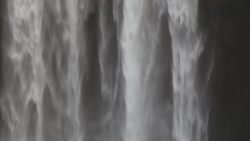 Close up of falling water as water wall at Skogafoss waterfall in Iceland.