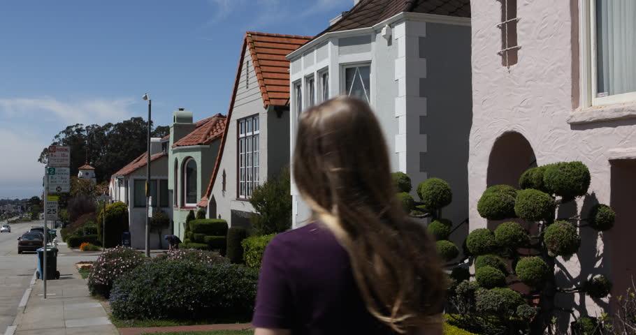 Young blonde woman walking on sidewalk street near houses in San Francisco, USA, UHD Ultra HD 4K 4096x2160 2160P