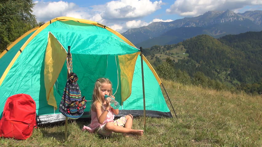 Child Drinking Water, Tent, Camping, Little Girl in Trip, Mountains, Kids Outing in Excursion - HD stock video clip