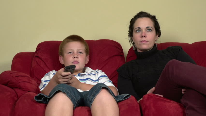 Happy family watching TV - HD stock footage clip