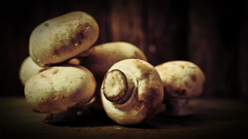 Mushrooms rustic background UHD stock footage. Mushrooms set against a rustic backdrop with a sliding camera move and negative space for text overlays.