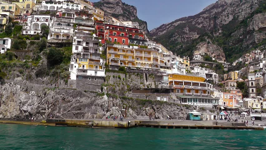 Sailing along Amalfi coast to Positano, beautiful old traditional town. Italy.