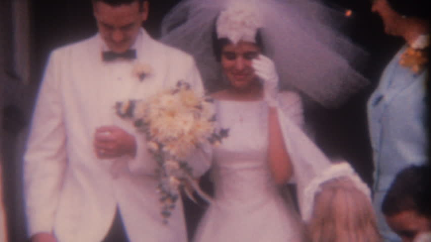 UNITED STATES - CIRCA 1950s: Old home movie film: Wedding ceremony celebration outside church
