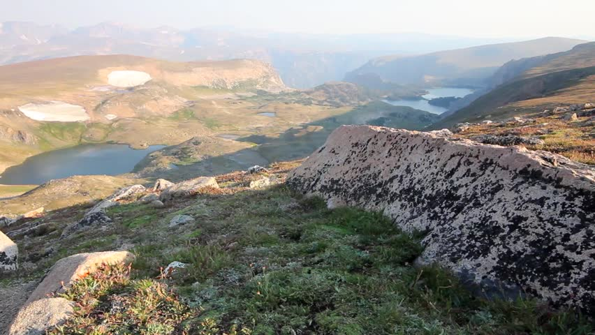 High on a mountain overlooking the Beartooth Plateau at sunrise. | Shutterstock HD Video #5930498