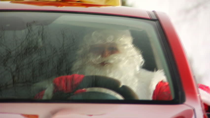 Stock video footage Santa drives a car - HD stock video clip