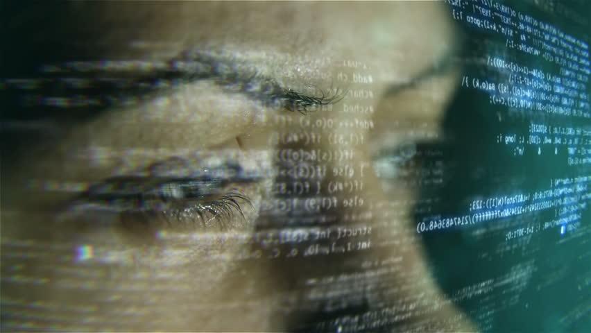 Futuristic developer with code hologram.