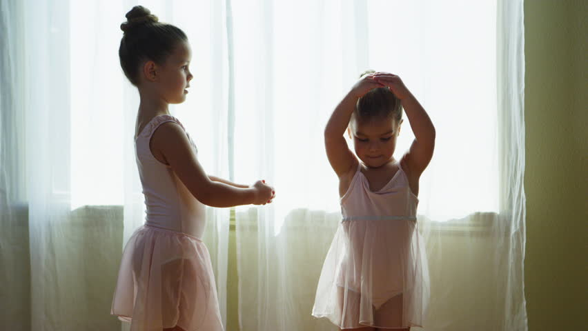 Young girls practicing ballet at home - 4k