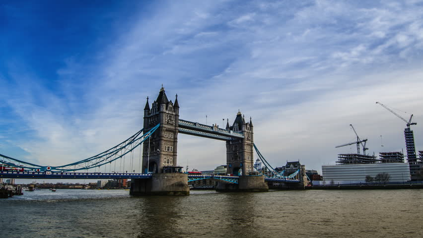 Tower Bridge in London with boats on the Thames and clouds floating in time lapse   Shutterstock HD Video #5950955