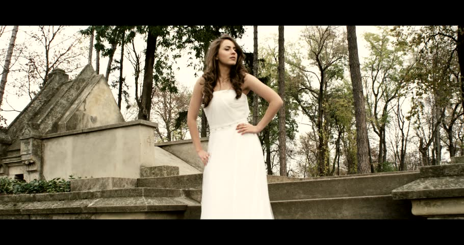 Beautiful bride in her wedding dress in front of a temple