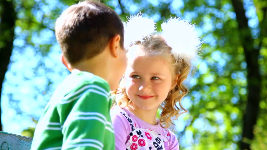 Little Boy Is Kissing Pretty Girl. Closeup Portrait. Cute ...