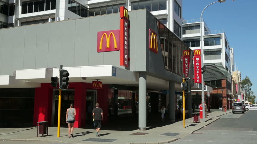 PERTH, WA/AUSTRALIA - FEBRUARY 15, 2014: Unidentified people enter McDonalds fast food. McDonald's is the world's largest chain of hamburger fast food restaurants. - HD stock footage clip