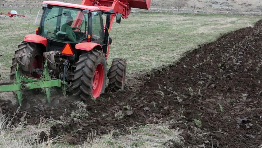 Tractor In Field Planting : Tractor plow farm field spring planting farmer on heavy