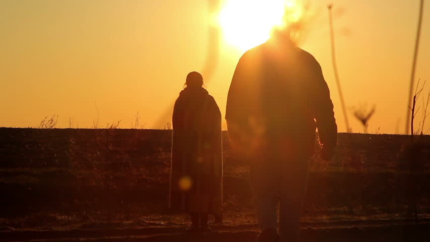 Man and woman at dawn,man and woman at sunrise under the blanket  - HD stock footage clip
