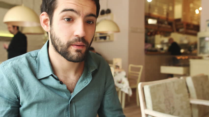 Handsome young man drinking wine in a restaurant | Shutterstock HD Video #6051323