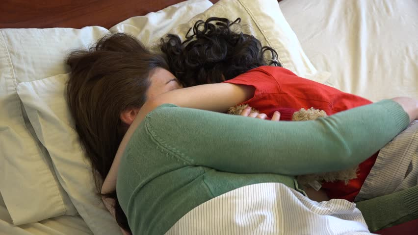 single mother and son sleeping together or sharing a