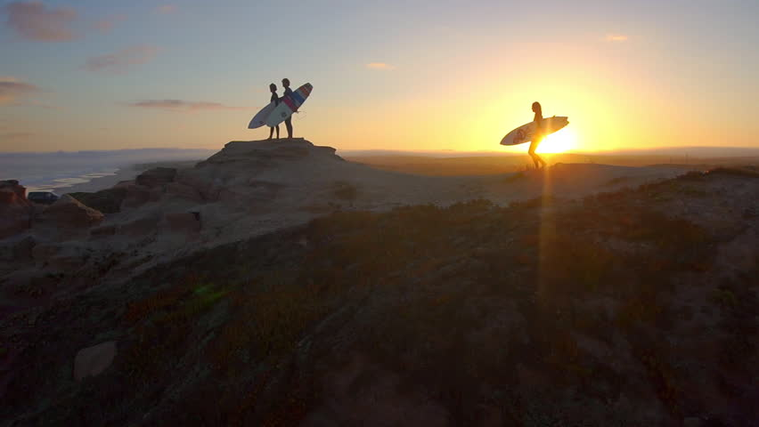 AERIAL: Surfers watching waves at sunset | Shutterstock HD Video #6075434