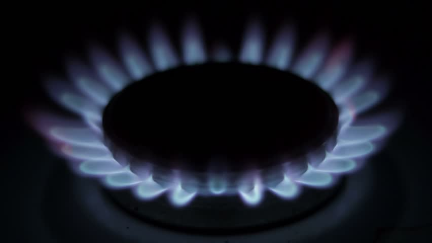 Flame of a gas burner in the kitchen stove gradually erupted with more force  - HD stock video clip