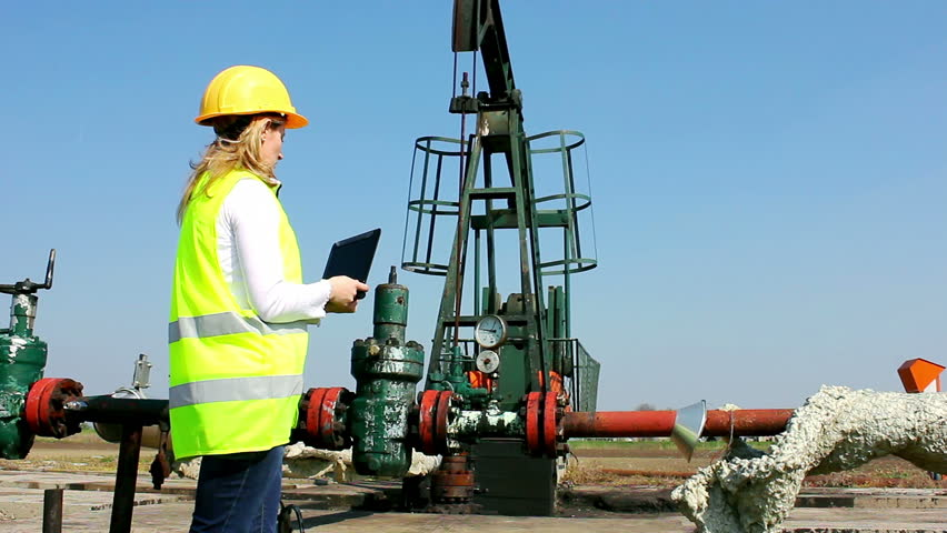 Oil Industry Pump jack with one oil worker - HD stock footage clip