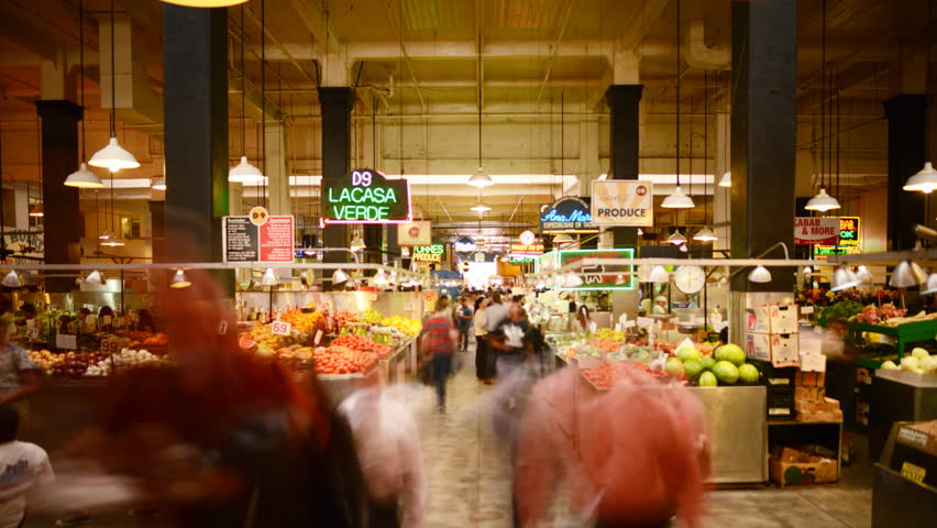 LOS ANGELES, California - April 9th: Time lapse Photography with tilt down motion of unrecognizable shoppers gather at historic Grand Central Market in Downtown Los Angeles on April 9th.