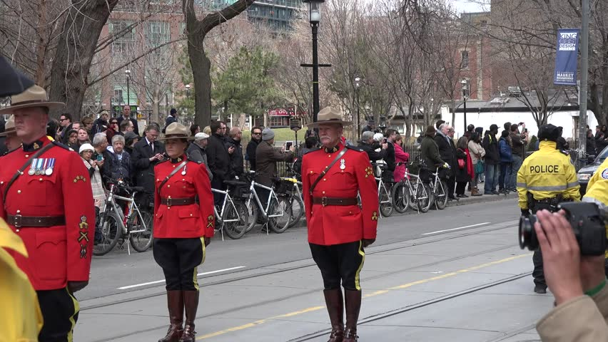 Toronto, Canada-April 16, 2014: Coffin arriving at Church. Scenes of the State Funeral for Jim Flaherty, former Minister of Finace of Canada, held at St. James Cathedral  - 4K stock video clip
