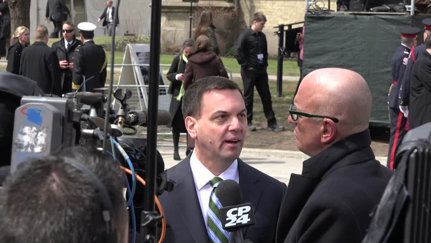Toronto, Canada-April 16, 2014: Tim Hudak, leader of Conservative Party in Ontario.Scenes of the State Funeral for Jim Flaherty, former Minister of Finace of Canada, held at St. James Cathedral