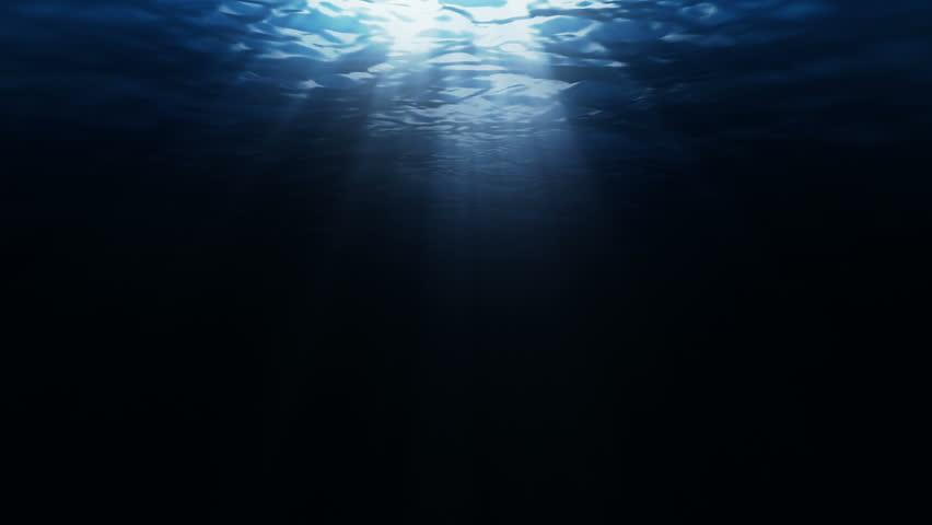 dark underwater scene with waves and sun lights stock