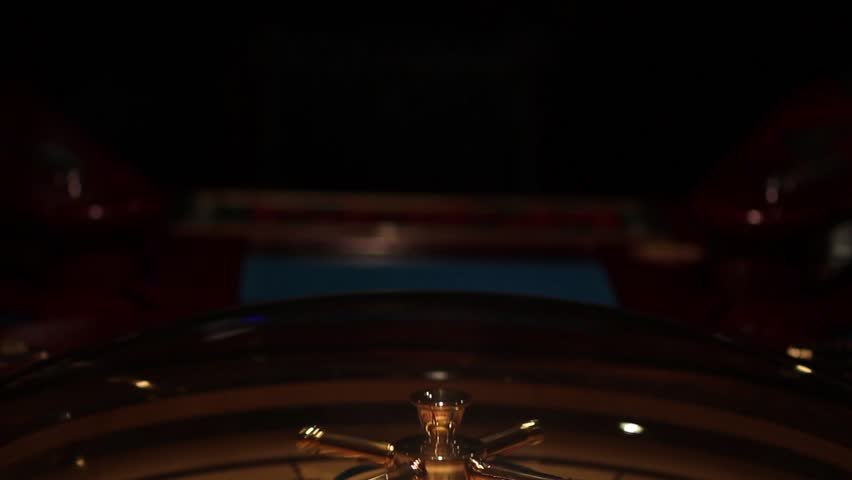 A footage of a casino roulette,the shot moves from the top to the bottom/Welcome to our club - HD stock footage clip